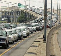 Cars carrying residents leave downtown New Orleans as Hurricane Katrina nears.