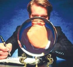 BUSINESSMAN LOOKING IN CRYSTAL BALL